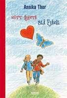 Omslagsbild till Rött hjärta blå fjäril.