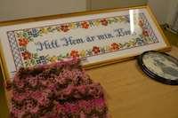 Broderad bonad med texten Mitt hem är min borg