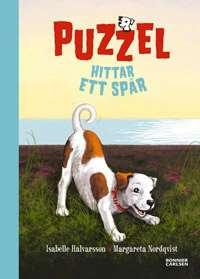 Omslagsbild till Puzzel hittar ett spår.